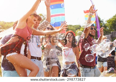 Friends enjoying a performance at a music festival Royalty-Free Stock Photo #298773827