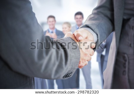Composite image of business people shaking hands close up #298782320