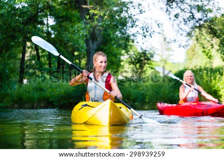 Woman paddling with canoe on forest river #298939259