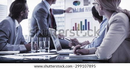 Young business people in board room meeting at the office Royalty-Free Stock Photo #299107895