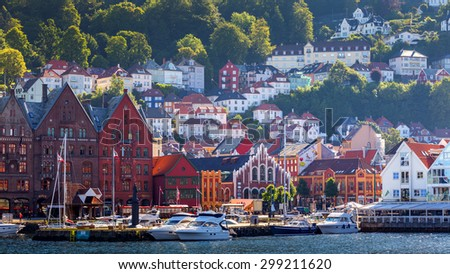 Bergen, NORWAY - 07 JULY, 2013 Famous Bryggen street with wooden colored houses on 07/07/2013, in Bergen, Norway #299211620