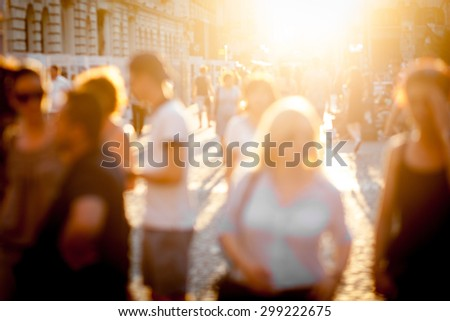 Color picture of blurred town scene at sunset