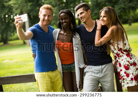 Young multiracial friends in the park #299236775