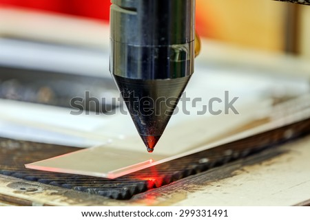 Red laser on cutting machine in physics laboratory #299331491