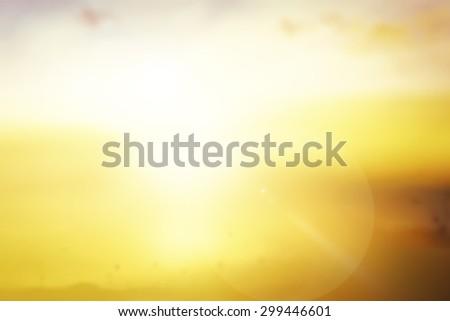 Summer holiday concept: Sun light and blur yellow garden sunrise background