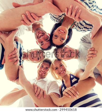 friendship, happiness and people concept - smiling friends in circle #299450618
