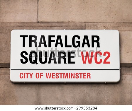 Sign indicating to the public they are in Trafalgar Square, best known for Nelson's Column, a huge monument towering the area at 169 feet and 3 inches, it's a tourist favorite and cultural hotspot.