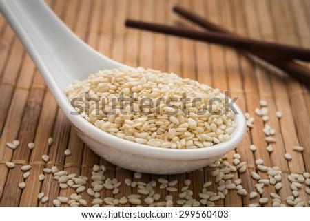 Sesame seeds on spoon #299560403