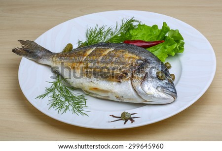 Grilled dorado with salad leaves and dill #299645960