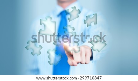 Close up of businessman's hand touching abstract puzzle piece #299710847