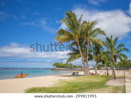 Honolulu, Hawaii, USA, July 25, 2015:  Afternoon view of Ala Moana Beach Park as a variety of sports take place in the warm waters of Hawaii.  Ala Moana Beach Park is Hawaii's premier park. #299811995