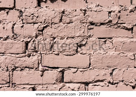 Stone wall background with cracked paint and holes #299976197