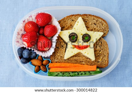 school lunch box for kids with food in the form of funny faces. the toning. selective focus Royalty-Free Stock Photo #300014822
