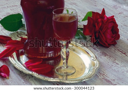 Liquor from rose petals on the wooden table #300044123