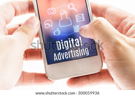 Close up hand holding mobile with Digital Advertising and icons, Digital Marketing concept. Royalty-Free Stock Photo #300059936