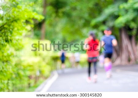 Blurred background of people activities in park with bokeh light, spring and summer #300145820