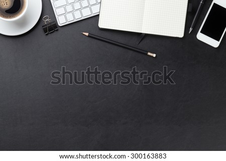 Office leather desk table with computer, supplies and coffee cup. Top view with copy space Royalty-Free Stock Photo #300163883