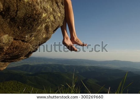 Beautiful landscape view from high mountaing on green hills with wood and human female legs barefoot of girl sitting on rock on natural blue sky copyspace background, horizontal picturepicture #300269660