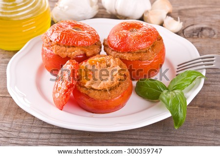 Stuffed tomatoes on a white plate.  #300359747