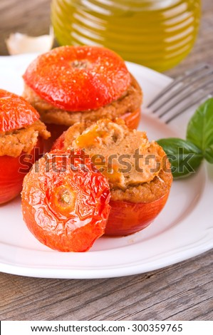 Stuffed tomatoes on a white plate.  #300359765