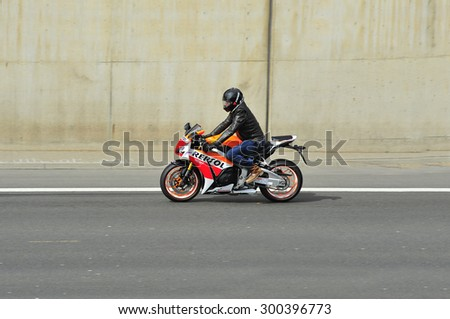 FRANKFURT,GERMANY - APRIL 16:unknown rider  on the highway on April 16,2015 in Frankfurt, Germany. #300396773
