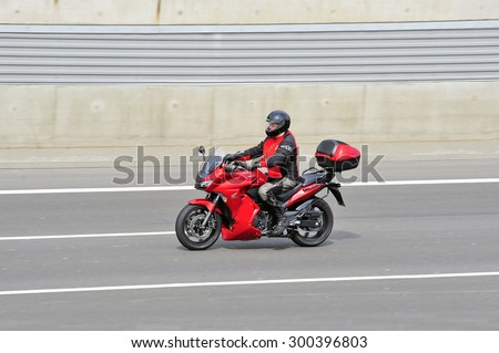 FRANKFURT,GERMANY - APRIL 16:unknown rider  on the highway on April 16,2015 in Frankfurt, Germany. #300396803
