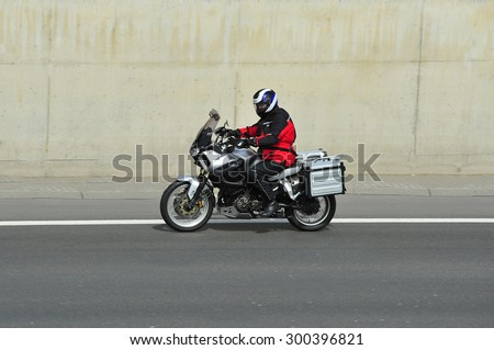 FRANKFURT,GERMANY - APRIL 16:unknown rider  on the highway on April 16,2015 in Frankfurt, Germany. #300396821