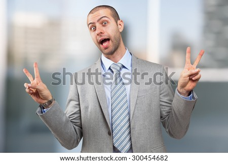 Funny businessman doing victory sign with both hands #300454682