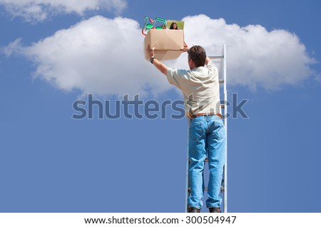 Cloud backup and storage concept showing a man on a ladder putting box of music and photos in cloud for storage