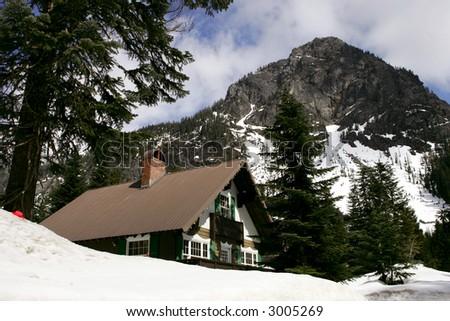 Ski chalet in snow mountains