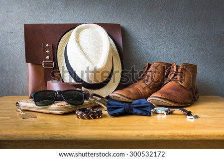 Men's casual outfits on wooden table over wall grunge background #300532172