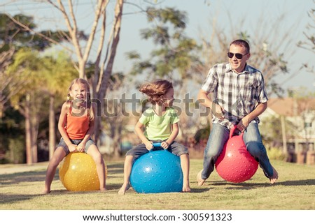 Dad and children playing on the lawn in front of house at the day time #300591323