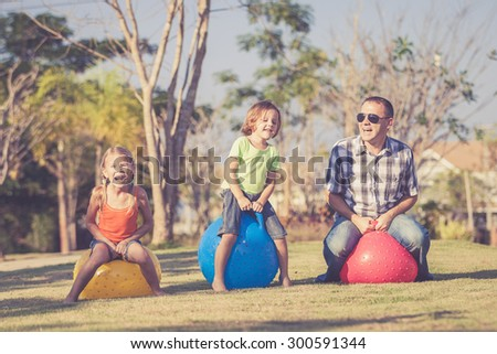 Dad and children playing on the lawn in front of house at the day time #300591344