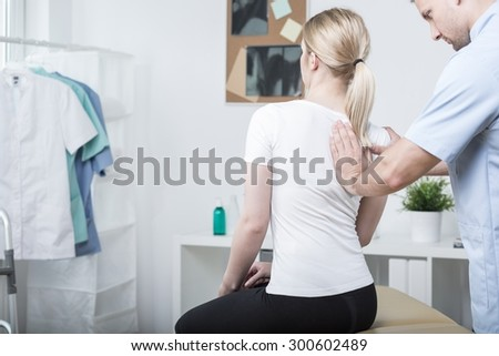 Chiropractic doing spinal mobilisation in physiotherapist's office #300602489
