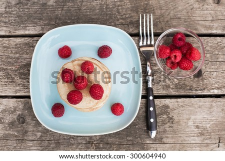 Pancakes with raspberries on plate #300604940