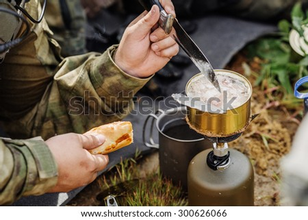 rangers team are heated food on the fire and eat in the forest #300626066
