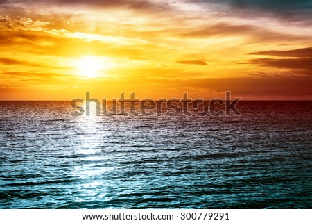 sunset at the sea with beautiful orange water and clouds #300779291
