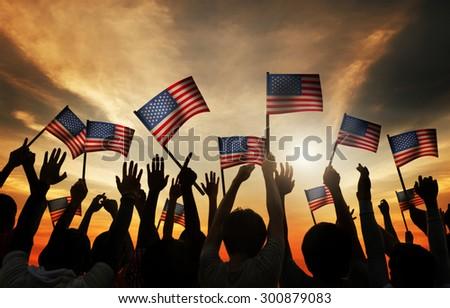 Group of People Waving Armenian Flags in Back Lit #300879083