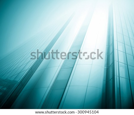 Panoramic and prospective wide angle view to steel light blue background of glass high rise building skyscraper commercial modern city of future. Business concept of successful industrial architecture #300945104