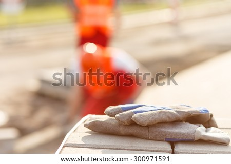 Close-up of work gloves on a construction site #300971591
