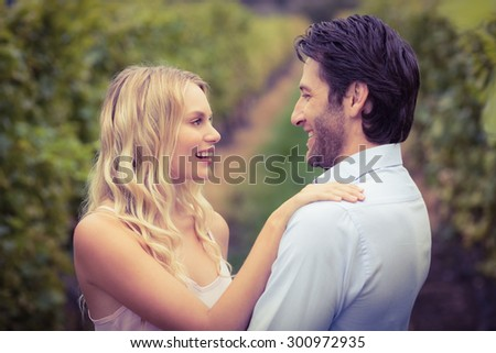 Young happy couple smiling at each other in the grape fields #300972935