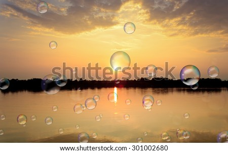 Soap bubbles on Gold light on sun set with light on the river. #301002680