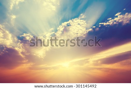 Soft focus, sunset sky with ray light in vintage filter.