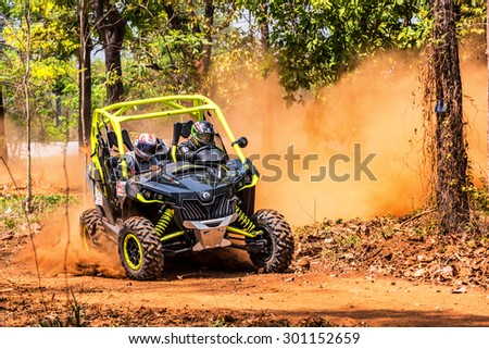 CHIANG MAI, THAILAND - MAY 03: Undefined Driver on Side-by-Side Vehicles (UTV) on countryside roads, May 03, 2015 in Chiang mai, Thailand. #301152659