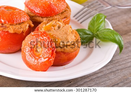 Stuffed tomatoes on glass bowl.  #301287170