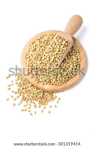 raw buckwheat and shovel in the wooden plate #301319414