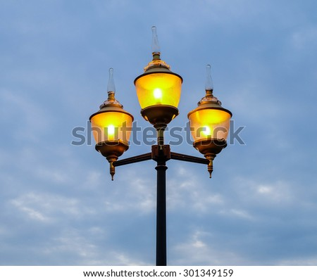 Beautiful street lamp on evening sky background #301349159