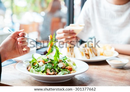 two people having a business meeting over lunch  #301377662