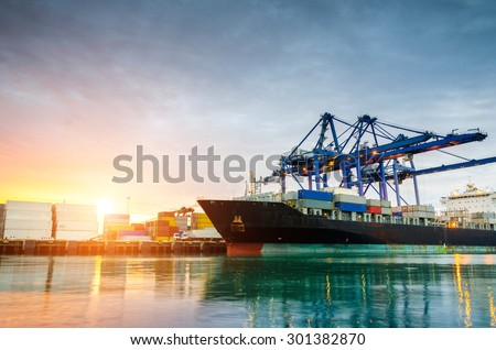 Containers loading by crane in the morning , Trade Port , Shipping Royalty-Free Stock Photo #301382870