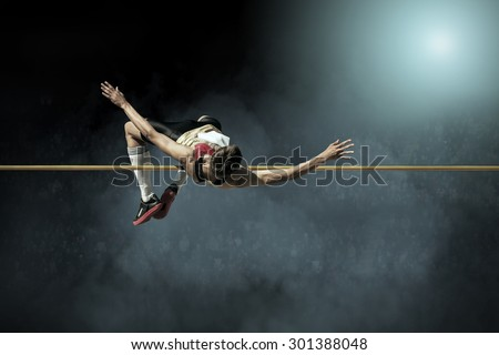 Athlete in action of high jump. Royalty-Free Stock Photo #301388048